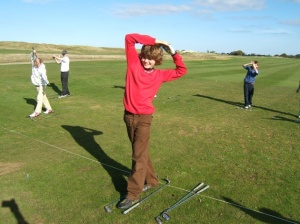 young golfer exercising balance during golf lesson