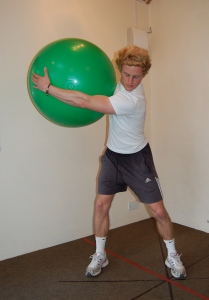 demonstrating a golf swing exercise